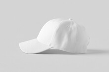 White Baseball Cap Mockup On A Grey Background, Side View.