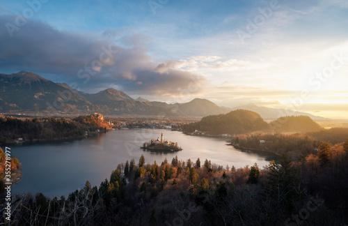 Fototapeta Bled landscape with island, lake and Julian Alps at sunrise in Slovenia obraz