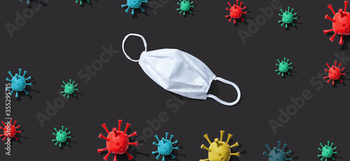 Fototapety, obrazy: Coronavirus theme with a disposable surgical face mask
