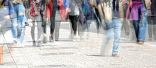 Crowd Of Abstract People Walking In The Shopping Pedestrian Zone, Multiple Exposure And Motion Blur, Panoramic Format, Copy Space