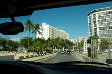 Driving On One Of The Main Roads In Puerto Rico As Seen Through The Windshield From The Inside Of A Car.