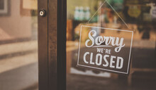 Label 'Sorry We're Closed' Notice Sign Wood Board Hanging On Door Front Coffee Shop. Vintage Style.