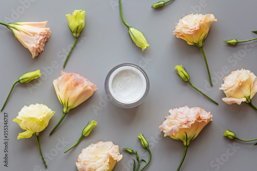 Obraz Facial cream on gray background with flowers. Flat lay, top view, mockup, template. High quality photo - fototapety do salonu