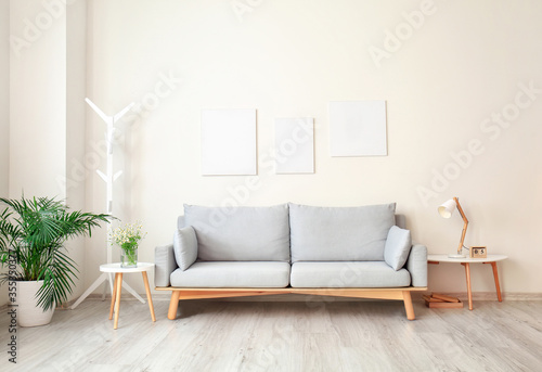 Obraz Interior of modern living room with comfortable sofa - fototapety do salonu