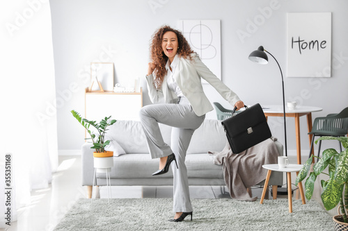 Obraz Happy businesswoman before weekends at home - fototapety do salonu