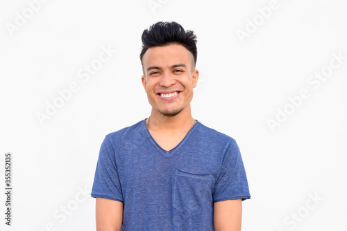 Face of happy young handsome multi ethnic man smiling against white background Wallpaper Mural