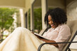 Leinwandbild Motiv African American woman studing and reading the Bible.