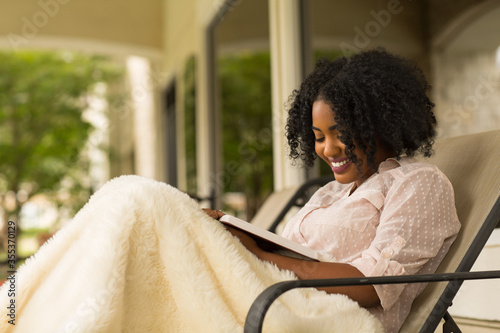 Obraz African American woman studing and reading the Bible. - fototapety do salonu