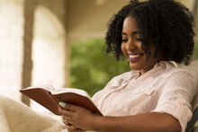 African American Woman Studing...