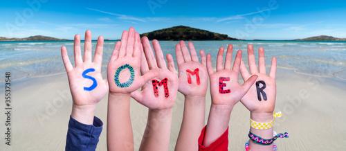 Fotografie, Obraz Children Hands Building Colorful German Word Sommer Means Summer