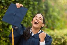 Young Hispanic Female Graduate At Her Graduation