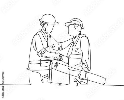 One line drawing of young architect holding on a roll paper and builder foreman wearing construction vest and helmet handshake to deal a project Canvas Print