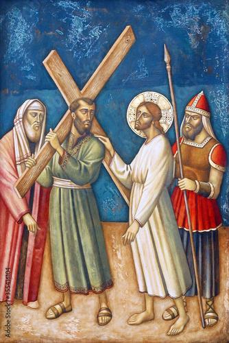 Obraz na plátně 5th Stations of the Cross, Simon of Cyrene carries the cross, Parish Church of t