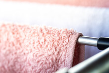Pink And White Towel Hanging O...
