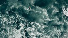 Surfer In Red Paddling In Stor...