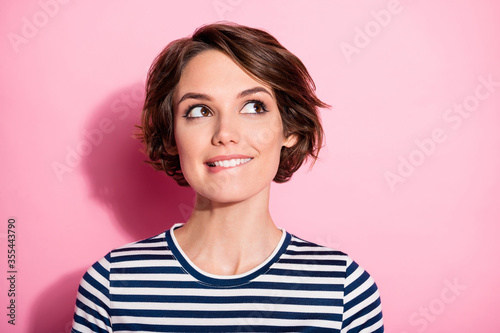 Fototapeta Close up photo of positive interested girl wait holiday bite lips look copyspace think thoughts expect what present she get wear stylish trend clothes isolated over pastel color background obraz