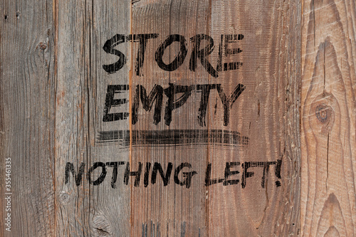 Text Store empty nothing left painted black on wooden boards Fototapet