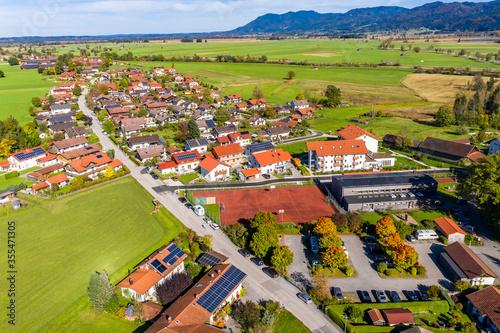Fototapeta Aerial view of Schlehdorf monastery with parish church St. Tertulin on Kochelsee, Schlehdorf Upper Bavaria, Bavaria, Germany obraz na płótnie