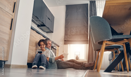 Fototapeta Happy dad and kid staying at home and enjoying the day obraz