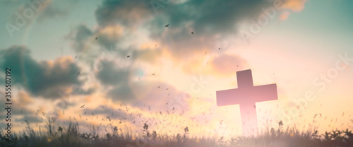 Silhouette jesus christ crucifix on cross on calvary sunset background concept f Wallpaper Mural
