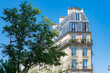 canvas print picture Paris, typical facades and street, beautiful buildings in Pigalle