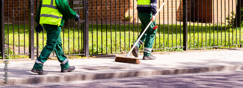 Fényképezés Street cleaners walking along in Hackney, London