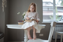 Blond Girl With Long Hair Read...