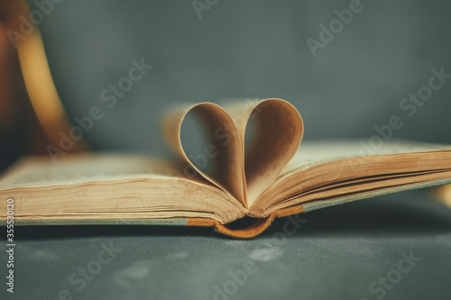 Obraz The pages of a book formed into a heart. Concept Love of reading and literature. - fototapety do salonu