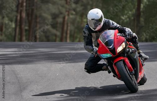 Tela Motorcyclist goes on road