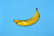 Rotten Banana On A Blue Backgg...