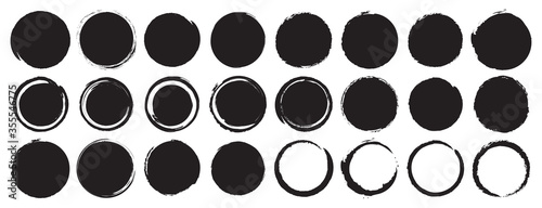 Fotografía Set of black grunge circles shapes on a white background