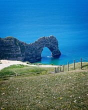 The Eroded Limestone Rock Formation Known As Durdle Door, A UNESCO World Heritage Site On The Jurassic Coast. Lulworth, Dorset, England, UK.