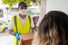 A Delivery Man With A Mask And...