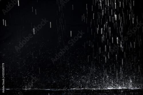 Fototapeta Rain Downpour splashing on edge surface obraz
