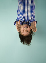 Happy Boy Hanging Upside Down