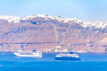 Two Large Cruise Ships Off The Sunny Coast Of Santorini