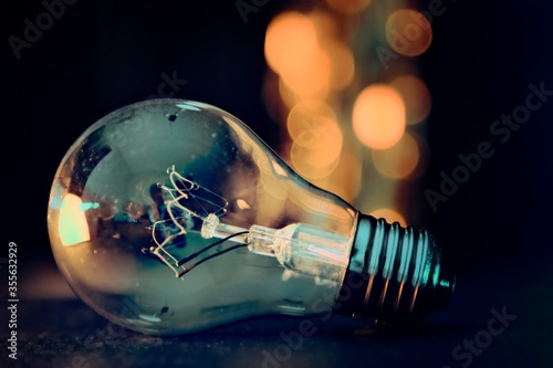 Photo light bulb in hand