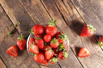 bowl of fresh strawberries on wood background