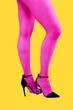 canvas print picture Close-up picture of woman's beautiful pink legs in high heels shoes on acid yellow color background. Disco lights. Fasion. Surreal art. Funny modern art collage. Pop art. Zine culture. Side view.