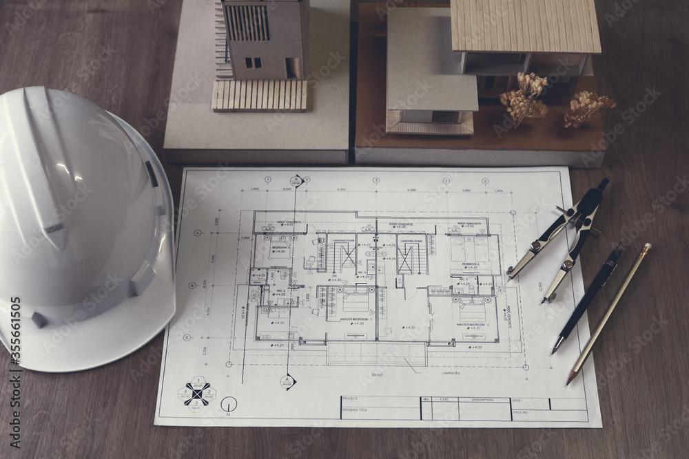 Fototapeta Top view, Blueprints Plans laptop and accessories on table.