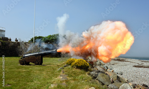 Historic Cannon firing at Fort Belan in Wales, UK.. Canvas Print