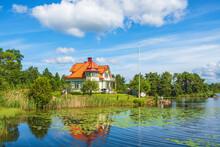 Idyllic House On A Hill At A Beautiful Lake