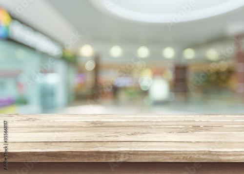 Obraz The wooden empty table top on blur background - fototapety do salonu