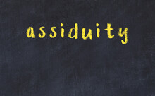 College Chalk Desk With The Word Assiduity Written On In