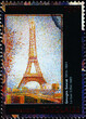 The Eiffel tower painted by Georges Seurat on postage stamp
