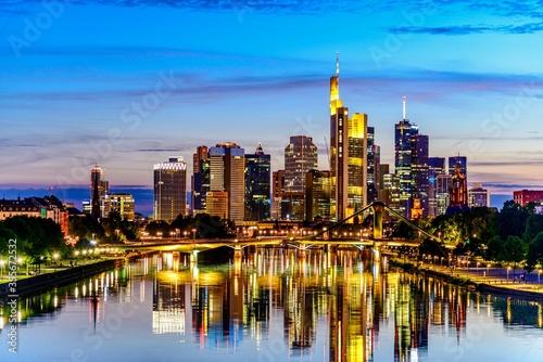 Beautiful view on  Frankfurt am Main downtown skyline cityscape, bridge with lights during twilight blue hour sunset, evening, night Canvas Print