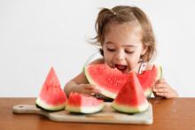 Hungry Toddler Girl Eating Wat...