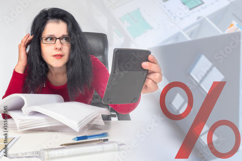 Woman with a surprised face next to the layout of the house Canvas Print