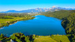Lake Weissensee in Bavaria - beautiful small lake in the Allgau district - aerial drone footage