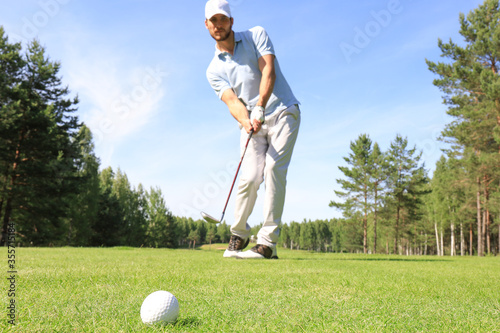 Full length of golf player playing golf on sunny day Wallpaper Mural